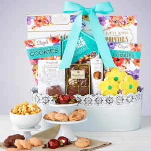 Mom will adore a super cute Mother's Day basket like a white wash gift basket with a lace doilly design brimming with premium treats.