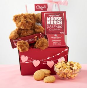 Red Hot Valentines Gifts! A soft cuddly brown bear is surrounded by sweets and chocolate treats makes an adorable valentine's day gift.