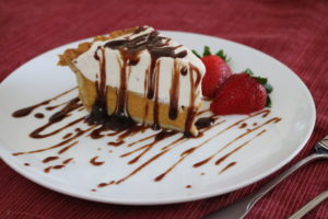 pumpkin pie with chocolate sauce
